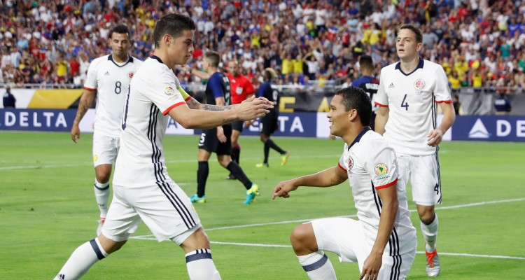 GLENDALE, AZ - JUNE 25: Carlos Bacca #7 of Colombia celebrates with James Rodriguez #10 after Bacca scored a first half goal against the United States during the 2016 Copa America Centenario third place match at University of Phoenix Stadium on June 25, 2016 in Glendale, Arizona.   Christian Petersen/Getty Images/AFP