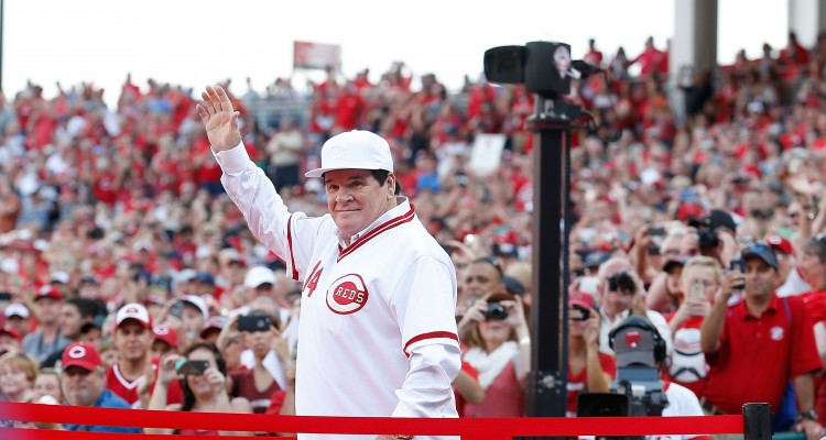 CINCINNATI, OH - JUNE 24: Cincinnati Reds great Pete Rose is introduced to the crowd as the 1976 World Series Championship team was honored prior to the start of the game between the Cincinnati Reds and the San Diego Padres at Great American Ball Park on June 24, 2016 in Cincinnati, Ohio.   Kirk Irwin/Getty Images/AFP