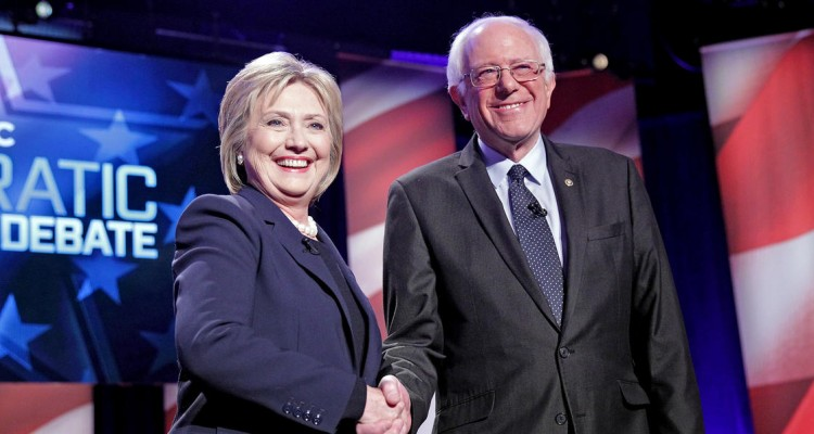 (Durham, NH, 02/04/16) Hillary Clinton and Bernie Sanders shake hands as they get ready for the MSNBC Democratic Candidates Debate on Thursday, February 4 at the University of New Hampshire.   Staff photo by Matt Stone