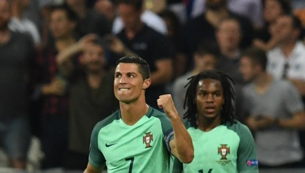 Portugal's forward Cristiano Ronaldo celebrates after scoring a goal during the Euro 2016 semi-final football match between Portugal and Wales at the Parc Olympique Lyonnais stadium in Décines-Charpieu, near Lyon, on July 6, 2016.  / AFP PHOTO / Francisco LEONG