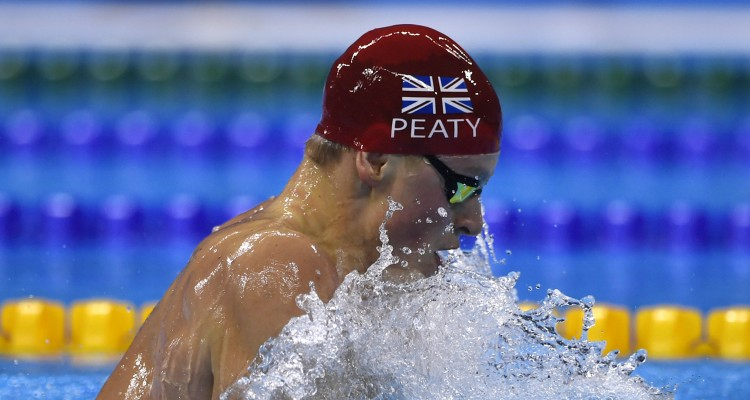 Britain's Adam Peaty competes to break the world record in the Men's 100m Breaststroke heat during the swimming event at the Rio 2016 Olympic Games at the Olympic Aquatics Stadium in Rio de Janeiro on August 6, 2016.   / AFP PHOTO / CHRISTOPHE SIMON