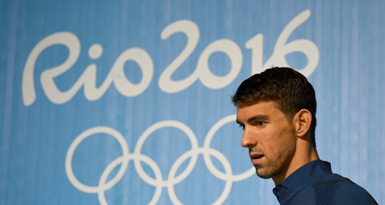 US swimmer Michael Phelps holds a press conference on August 3, 2016 in Rio de Janeiro, two days prior the opening ceremony of the Rio 2016 Olympic Games. Phelps will carry the United States flag at the opening ceremony for the Olympics in Rio, the US Olympic Committee said. / AFP PHOTO / Martin BUREAU