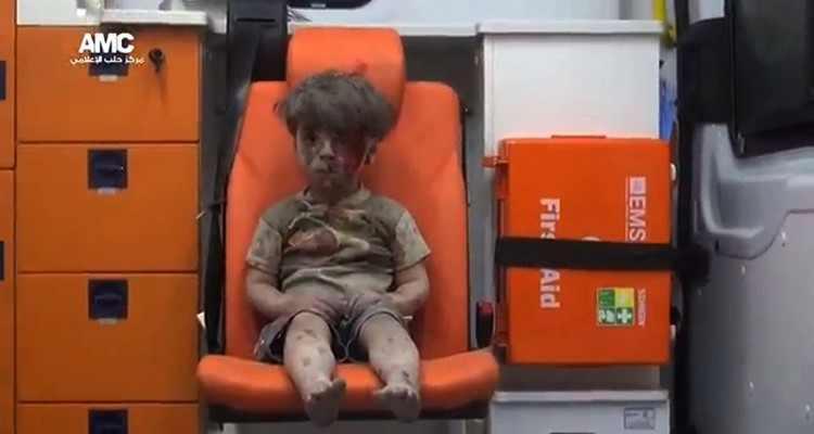 "An image grab taken from a video uploaded by the Syrian opposition's activist group Aleppo Media Centre (AMC) on August 17, 2016 is said to show a young Syrian boy covered in dust and blood sitting in shock in an ambulance after being rescued from the rubble of a building hit by an air strike in the rebel-held Qaterji neighbourhood of the northern Syrian city of Aleppo. / AFP PHOTO / AMC / HO / === RESTRICTED TO EDITORIAL USE - MANDATORY CREDIT ""AFP PHOTO / HO / AMC "" - NO MARKETING NO ADVERTISING CAMPAIGNS - DISTRIBUTED AS A SERVICE TO CLIENTS FROM ALTERNATIVE SOURCES, AFP IS NOT RESPONSIBLE FOR ANY DIGITAL ALTERATIONS TO THE PICTURE'S EDITORIAL CONTENT, DATE AND LOCATION WHICH CANNOT BE INDEPENDENTLY VERIFIED ===   /"