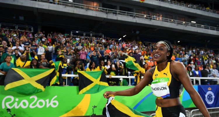 Jamaica's Elaine Thompson celebrates after she won the Women's 100m Final during the athletics event at the Rio 2016 Olympic Games at the Olympic Stadium in Rio de Janeiro on August 13, 2016.   / AFP / FRANCK FIFE        (Photo credit should read FRANCK FIFE/AFP/Getty Images)