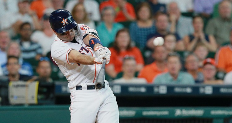 HOUSTON, TX - AUGUST 31: Jose Altuve #27 of the Houston Astros triples in the eighth inning against the Oakland Athletics at Minute Maid Park on August 31, 2016 in Houston, Texas.   Bob Levey/Getty Images/AFP