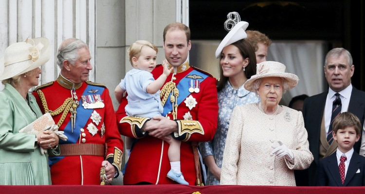 Britain's Camilla The Duchess of Cornwall, Prince Charles, Prince Willian holding Prince George, Catherine, the Duchess of Cambridge, Queen Elizabeth, and Prince Andrew stand on the balcony at Buckingham Palace in London