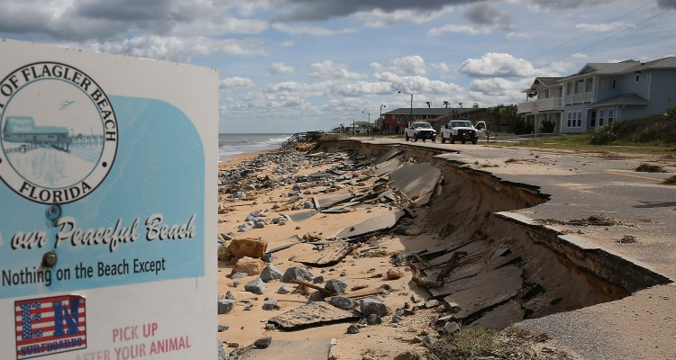 FLAGLER BEACH, FL - OCTOBER 08: A1A is seen after ocean waters stirred up by Hurricane Matthew washed away part of the ocean front road on October 8, 2016 in Flagler Beach, Florida. Across the Southeast, Over 1.4 million people have lost power due to Hurricane Matthew which has been downgraded to a category 1 hurricane on Saturday morning.   Joe Raedle/Getty Images/AFP