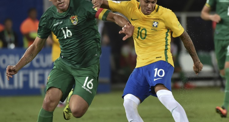 Brazil's Neymar (R) is marked by Bolivia's Ronald Raldes during their Russia 2018 World Cup football qualifier match in Natal, Brazil, on October 6, 2016. / AFP PHOTO / Nelson ALMEIDA