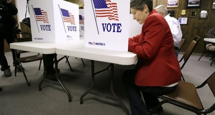 Republican Senate candidate State Sen. Joni Ernst casts her ballot in the general election, Tuesday, Nov. 4, 2014, in Red Oak, Iowa. Ernst is running against Democrat U.S. Rep. Bruce Braley for the U.S. Senate seat of Tom Harkin, who is not seeking reelection. (AP Photo/Charlie Neibergall)