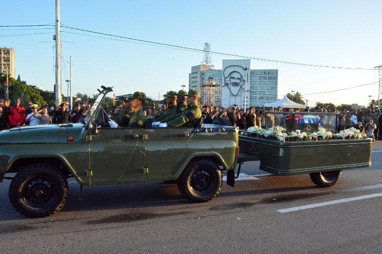 "The urn with the ashes of Cuban leader Fidel Castro leave the Revolution Square in Havana starting a four-day journey across Cuba, November 30, 2016. The ""caravan of freedom"" will leave from Havana, making symbolic stops along the 950-kilometer (590-mile) trek that will end in the eastern city of Santiago de Cuba over the weekend. / AFP PHOTO / ADALBERTO ROQUE"