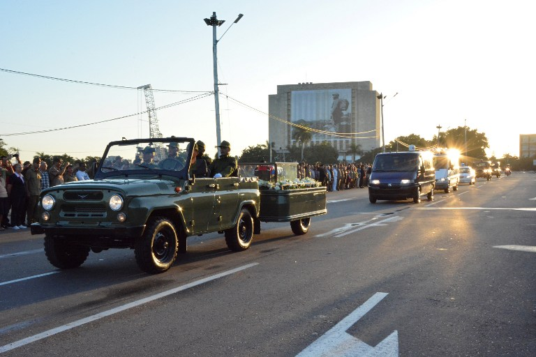 """The urn with the ashes of Cuban leader Fidel Castro leave the Revolution Square in Havana starting a four-day journey across Cuba, November 30, 2016. The """"caravan of freedom"""" will leave from Havana, making symbolic stops along the 950-kilometer (590-mile) trek that will end in the eastern city of Santiago de Cuba over the weekend. / AFP PHOTO / ADALBERTO ROQUE"""