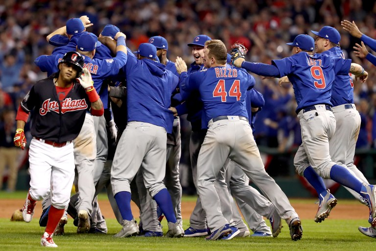 CLEVELAND, OH - NOVEMBER 02: The Chicago Cubs celebrate after defeating the Cleveland Indians 8-7 in Game Seven of the 2016 World Series at Progressive Field on November 2, 2016 in Cleveland, Ohio. The Cubs win their first World Series in 108 years. Elsa/Getty Images/AFP