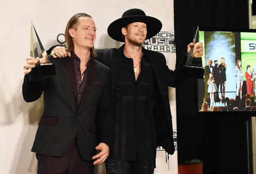 LOS ANGELES, CA - NOVEMBER 22: Recording artists Tyler Hubbard (L) and Brian Kelley of Florida Georgia Line, winners of Favorite Country Duo/Group, pose in the press room during the 2015 American Music Awards at Microsoft Theater on November 22, 2015 in Los Angeles, California. (Photo by Jason Merritt/Getty Images)