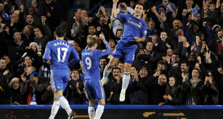 Chelsea's Branislav Ivanovic, right, celebrates scoring his side's third goal , during the English Premier League soccer match between Chelsea and Aston Villa at Stamford Bridge stadium in London, Sunday, Dec. 23, 2012.  (AP Photo/Tom Hevezi)