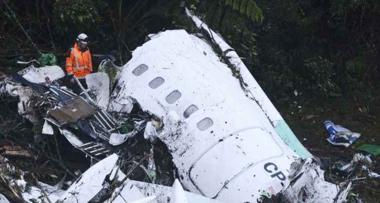 Rescue workers search at the wreckage site of a chartered airplane that crashed outside Medellin, Colombia, Tuesday, Nov. 29, 2016. The plane was carrying the Brazilian first division soccer club Chapecoense team that was on it's way for a Copa Sudamericana final match against Colombia's Atletico Nacional. (AP Photo/Luis Benavides)