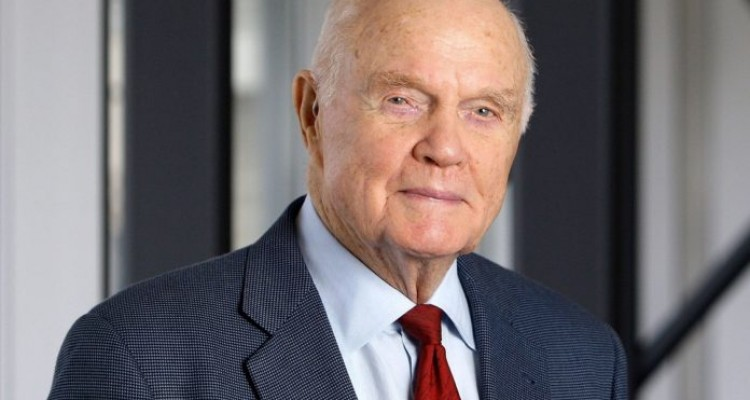 In this Jan. 25, 2012 photo, Sen. John Glenn poses at his office in Columbus, Ohio. Glenn was the first American to orbit Earth, piloting Friendship 7 around the planet three times in 1962. Glenn, as a U.S. senator at age 77, also became the oldest person in space by orbiting Earth with six astronauts aboard shuttle Discovery in 1998. (AP Photo/Jay LaPrete)